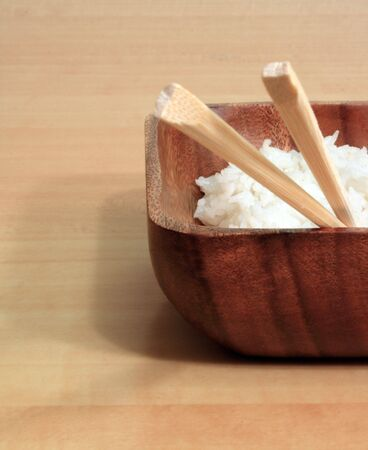 Bowl of Rice with Wooden Chopsticks Stock Photo