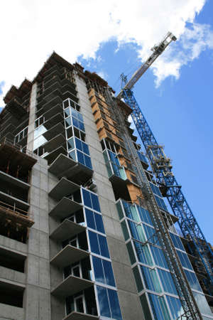 Highrise building under construction on a clear sunny day. Stock Photo