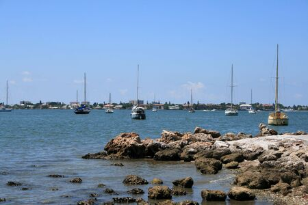 Sailboats by the seashore on a beautiful day in south Florida. Stock Photo