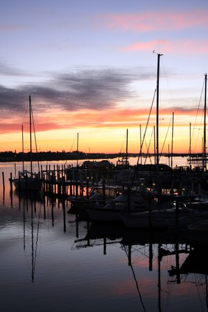 Sunrise at a marina in south Florida.  Beautiful colors accent the background of this scene.