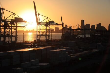 Sunset at the shipyard in the Port of Miami.  Containers waiting to be loaded and taken to their destination.