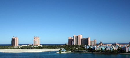 Atlantis Resort and Casino on Paradise Island in Nassau, Bahamas.  Colorful homes and shops also decorate the island. Stock Photo