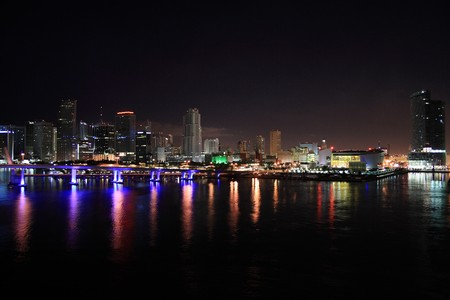 Night shot of downtown Miami Florida.  Port of Miami on the water.