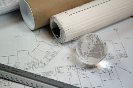 Global Architecture Concept.  Glass globe with architects tools and blueprints.