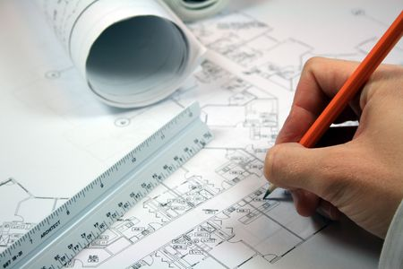 Architect working with blueprints.  Closeup with intentional focus on pencil and architect ruler. Stock Photo