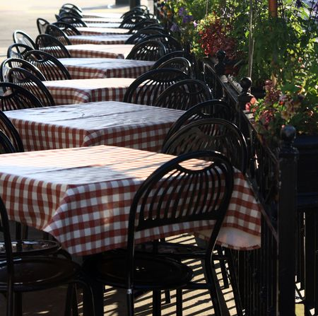 Outdoor cafe table settings.  Located outside a bistro in San Francisco. Stock Photo