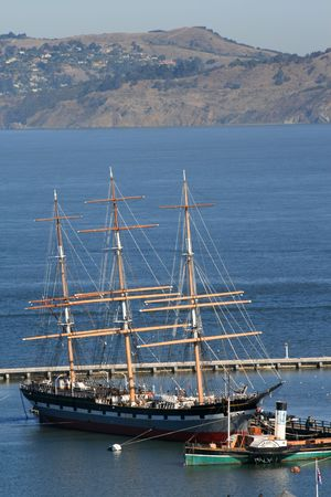 Ship from the San Francisco Maritime Museum docked in the bay on a beautiful day.