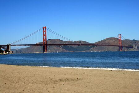 Beautiful view of the Golden Gate Bridge from the beach.  Located in San Francisco, California.