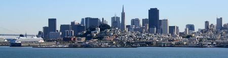 San Francisco panorama on a beautiful day.  Bay Bridge, cruise ships, Coit Tower, and downtown can all be seen.