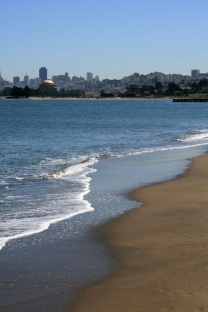 The beach on San Francisco Bay.  Shown on a beautiful day with the city as the backdrop.