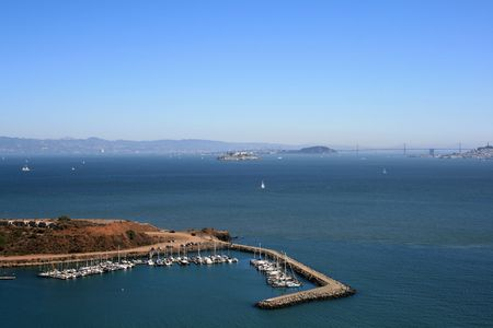 Elevated View of Alcatraz and San Francisco Bay.  Sailboats and blue skies show in this beautiful day. Stock Photo