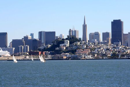 Sailboats on San Francisco Bay.  Beautiful skyline in the backdrop with downtown, coit tower, and pier 39 showing. Stock Photo