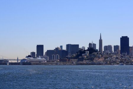 View of downtown San Francisco from the bay.  Cruise ships, Bay Bridge, and Downtown can all be seen on a beautiful day. Stock Photo