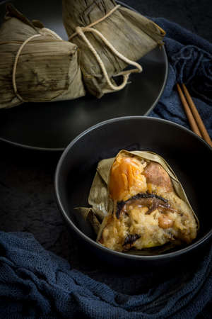 Zongzi or Traditional Chinese Sticky Rice Dumplings (Dark Food Photography)