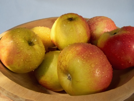 washed: Freshly washed apples on a wooden bowl