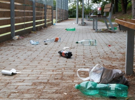 Rubbish on the sidewalk in the city park