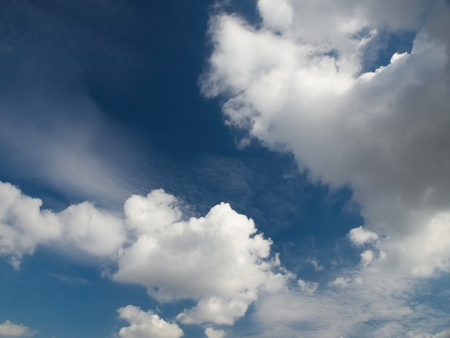 Deep blue sky with white clouds Stock Photo