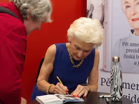 PRAGUE - MAY 13, 2017: Eliska Haskova - Coolidge, former longtime employee of the White House since 1963, autographing her book on Book World Prague 2017 - 23rd International Book Fair and Literary Festival    Chinese writer and dissident Liao I Wu on Boo Editorial