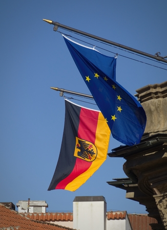 Waving flags of Germany and the European Union.