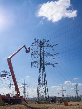 Maintenance with forklift platform on high voltage lines.