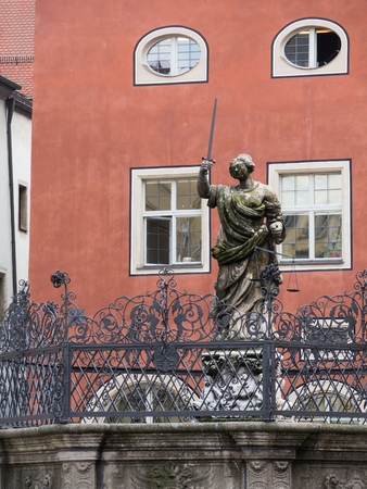 Partial capture of Fountain of Justice  - Justitiabrunnen  the Haidplatz in Regensburg, Germany.