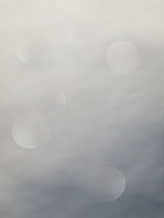 Background of off focus bokeh from shadows in snow. Stock Photo