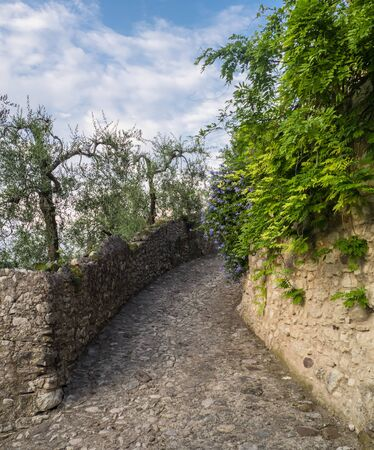 Little road of Castello village in the north of Italy near to Lake Garda. Stock Photo