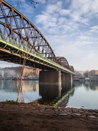 Old railway bridge over the Vltava river in Prague