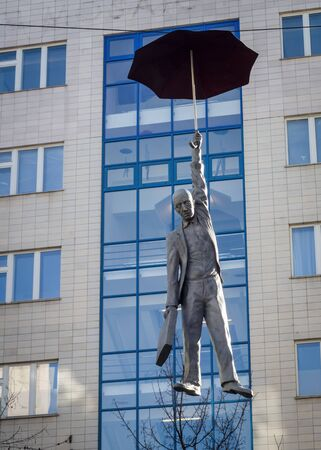 PRAGUE - FEBRUARY 10, 2020: Sculpture of man with umbrella from instalation of Slight Uncertainty of Michal Trpak.