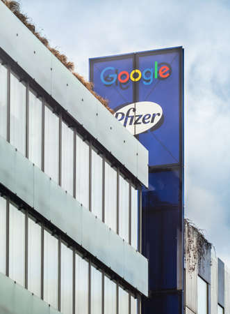 PRAGUE - FEBRUARY 26, 2020: Logo of Google and Pfizer on office building on Stroupeznikeho street in Smichov quarter.