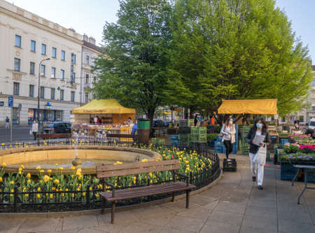 PRAGUE, CZECH REPUBLIC – APRIL 20, 2020: Reopening of farmers' market in Tylovo Square for the first time after their closure in relation to the COVID-19 pandemic. Editorial