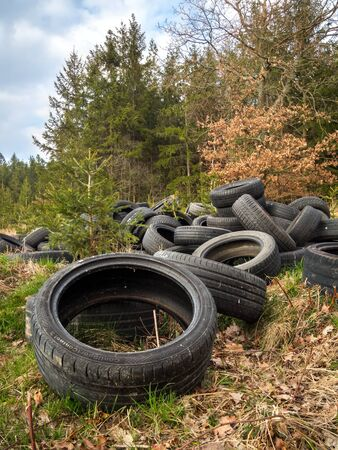 ZVANOVICE, CZECH REPUBLIC – APRIL 4: Illegal tire dump at the edge of the forest Stock Photo