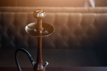 Stylish hookah made of glass and wood Stock Photo
