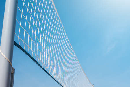 Mesh for beach volleyball on a sunny summer day Stock Photo
