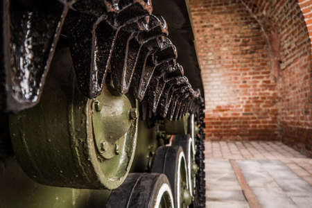 Caterpillars of the old Soviet military machine. In the park there are exhibits of military equipment.
