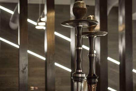 Beautiful glass hookah on a wooden table in a hookah bar Banco de Imagens