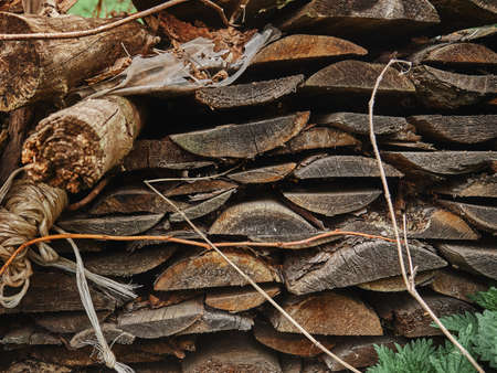 A stack of old boards lying outdoors near the barn. texture