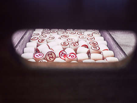 Wooden lotto barrels in a wooden box. Family game,