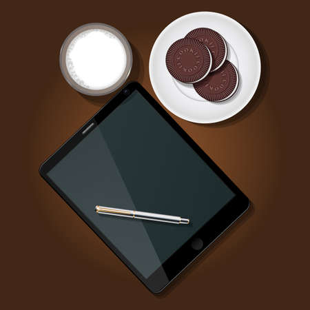 milk and cookies: top view of tablet with milk glass and chocolate cookies on plate