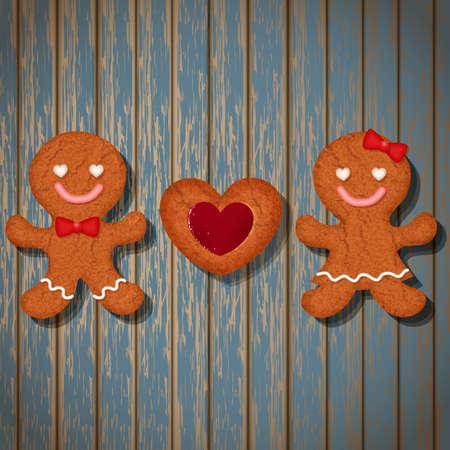 bułka maślana: loving couple of gingerbread cookies and strawberry heart cookie on wood background