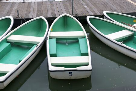 green boat: Green boat on a river