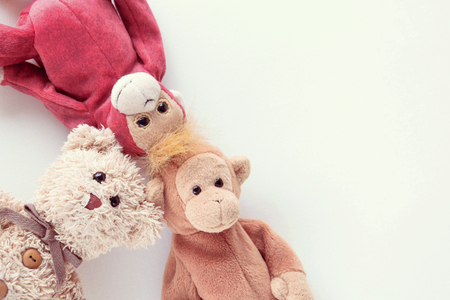 The gang of doll,Teddy bear and couple monkey lying down on white background.