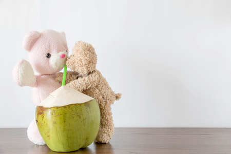 Teddy bears are drinking coconut water