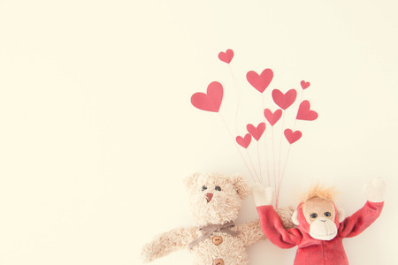 Cute couple monkey and teddy bear with red balloons isolated white background that they are happy and smiling ,Happy concept Stock Photo