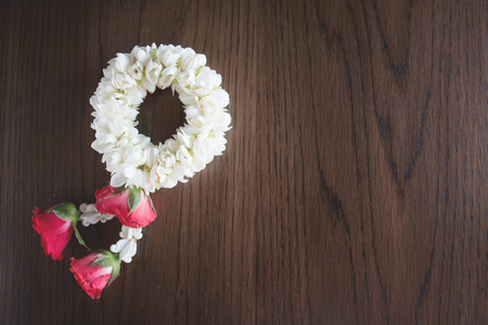 Thai flower garland on wood background  in still life style Stock Photo
