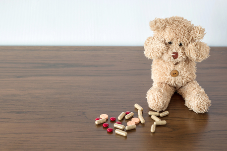 teddy bear dont want take a medicine and depression sitting on the floor