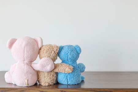 Three teddy bears holding in one's arms ,Happy feel