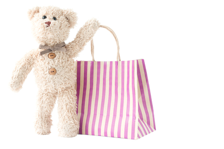 Cute bear doll holding shopping bag with happy feel Banco de Imagens