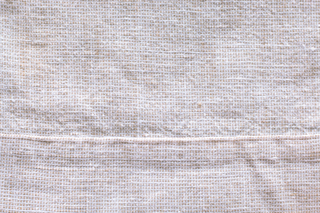Texture of cotton 45% and linen 55% fabric creased gray cloth material fragment