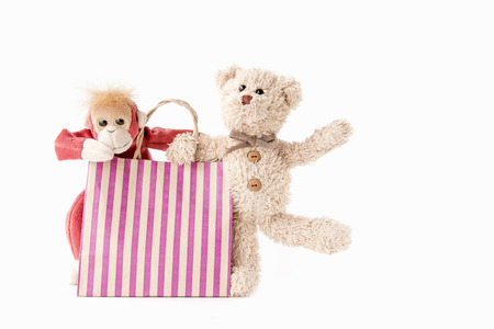 Cute teddy bear and monkey with shopping bag in  happy feel Stock Photo